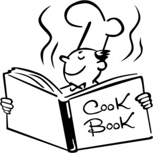 A chef opening a cook book